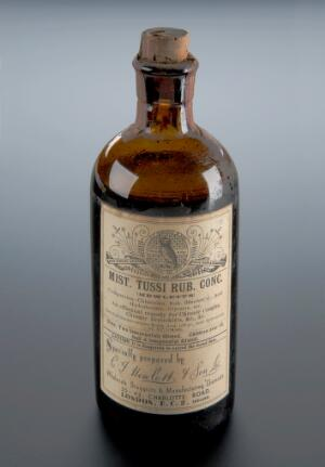 view Brown glass bottle of cough mixture, London, England, 1925-1