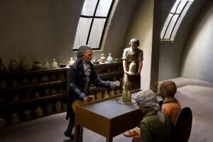 """view Diorama """"The Advance of Physiology"""" showing Lavoisier, carrying out an experiment in Paris in 1789, made by Wellcome Institute, London, 1945-1960. Detail view of experimaent and medicine bottles."""