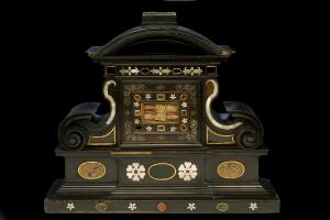 view Elaborately carved and inlaid wooden reliquary chest containing relics of several saints, Spanish (?) 18th century. Full straight on view. Black background.