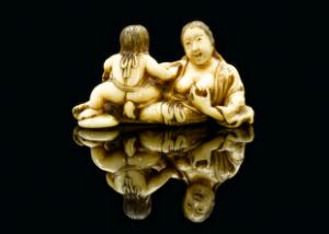 view Ivory netsuke showing a mother breastfeeding a child, Japan, 1701-1900