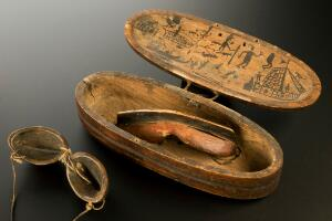 view Wooden snow goggles and case, Inuit, North America, 1801-190