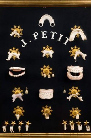 view Dentist's window display, France, 1875-1885