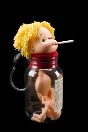 view 'Smokey Sue Smokes for Two', health education doll, England,