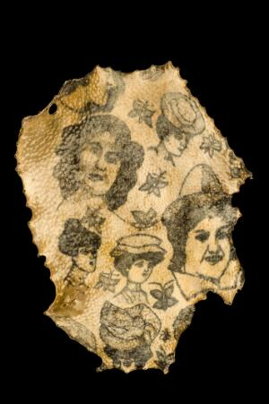 view Human skin, with tattoos of women's heads, France, 1900-1920
