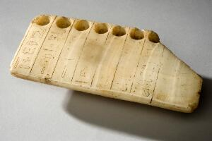 view Stone slab with seven holes for cosmetic ointments, Egypt, 1