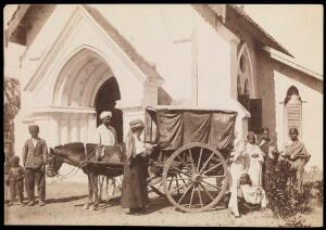 view South India: a cart drawn by a donkey bringing women patients to a medical mission. Photograph by A.R. Slater, 19--.