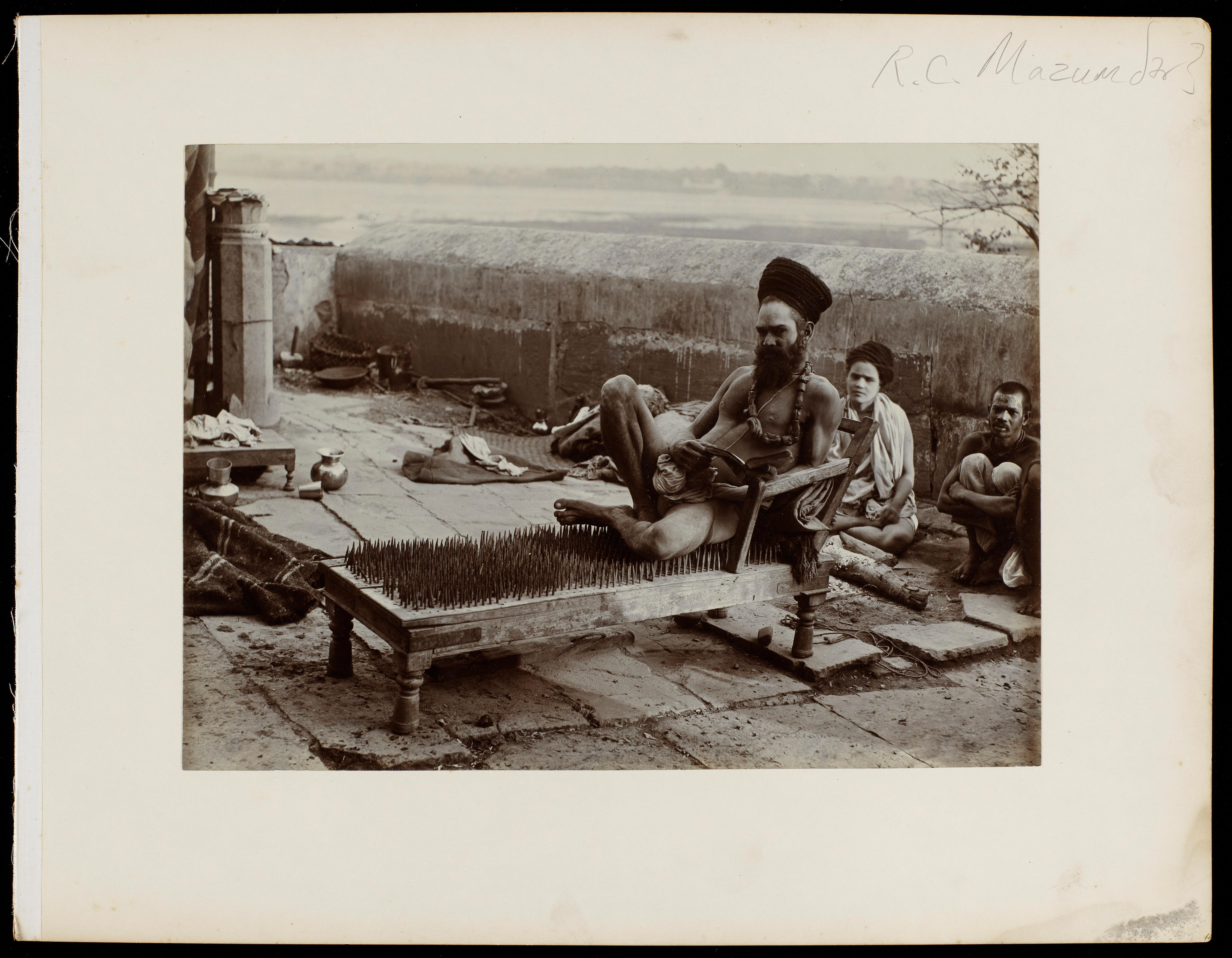 Benares India A Fakir Sitting On A Bed Of Nails Photograph By