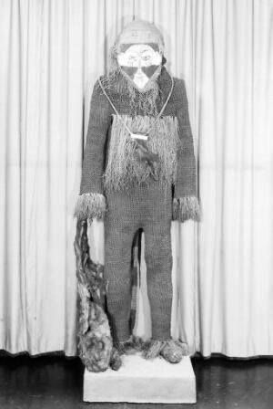 view African medicine man, string knitted suit, black & white mask
