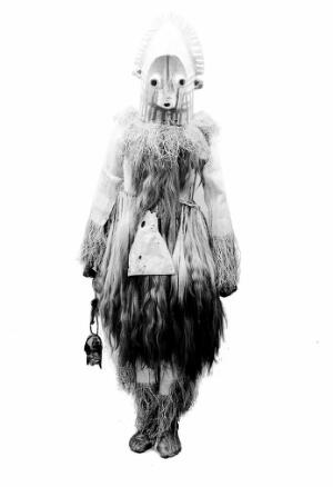 view African medicine man, dress with horsehair and grotesque mask