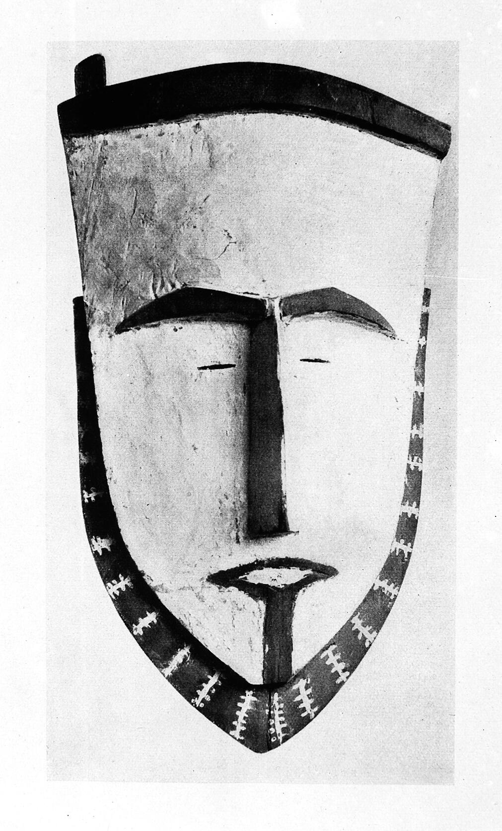 Mask, carved wood, shield shape, painted border  African