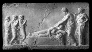 view Fragment of bas-relief in the from of a temple. A girl patient on a bed, Aesculapius stands above her. Bas-relief, plaster cast from the original in Athens. Greece