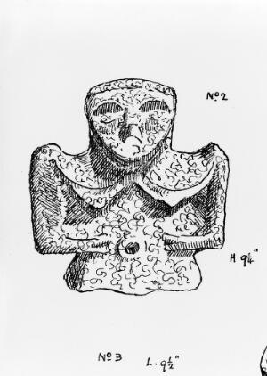 view Female image on Charm, carved from a piece of coal