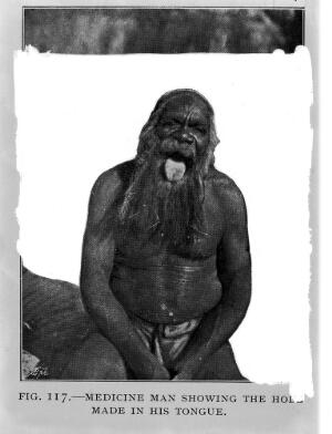 view Medicine man showing the hole made in his tongue