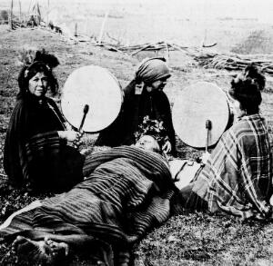view Mapuche medicine woman treating a patient, South Chile.