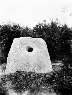 view Holed Stone, Clock-A-Torill. Tullon. Co. Carlon. Clothes are passed through the Apertures for cures.