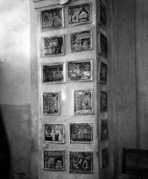 view Votive tablets in the Church of Santa Marie de Bagni. Deruta. Pillar showing 18 tablets.