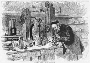 view Portrait of Louis Pasteur in his laboratory using a microscope.