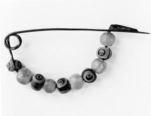 view Fibula-bow type-decorated with beads, Iron Age. Halstatt II