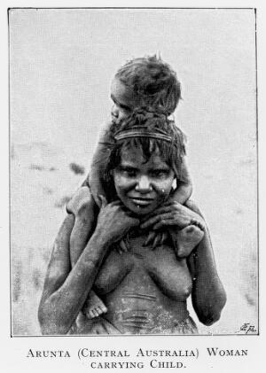 view Child carried on mother's shoulders, Central Australia.