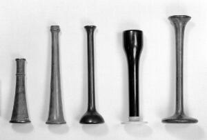 view 4 Stethoscopes. A- small, funnel-shaped, lined with brass. B- obatined from Italy. C- obtained from Italy. D- bell shaped, probably 1850s to 1860s. E- probably Stoke's type.