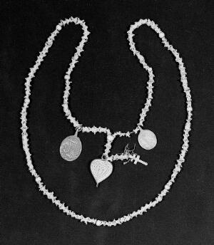 view Necklet of the vertebrae of an adder hung with 3 medallions.