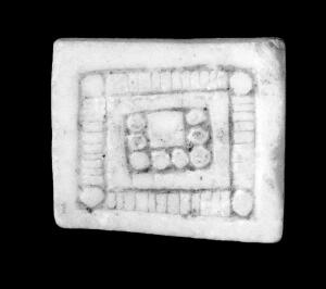 view Amuletic objects of stone to ensure fertility, Bolivia. In the form of square plaques, decorated.