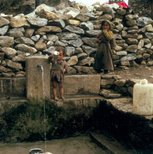 view Nepal; Sherpa children at a water pipe, 1986