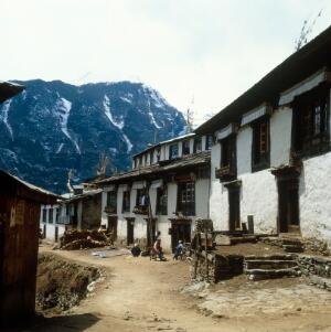 view Nepal; town life in the Khumbu, 1986. A street in Namche Bazar (altitude 3446 metres). Men relax outside a store. In the mid-1980s, Nepal was rigidly patriarchical although Sherpa women had more autonomy than other groups. Women generally had limited access to markets, education, health care and local government. Malnutrition and poverty hit them the hardest, and female children were usually given less food than male children, especially during food shortages.