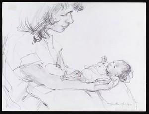 view Nurse holding a premature baby