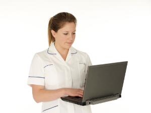 view Young white female health professional in uniform with laptop