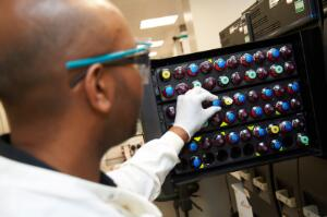 view Young male scientist in a laboratory