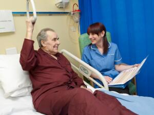 view A nurse carrying out observations on a patient