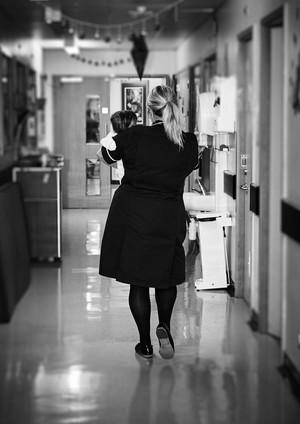 view Paediatric nurse with infant