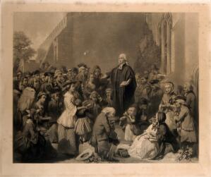 view John Wesley preaching outside a church. Engraving.