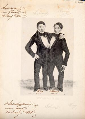 view Chang and Eng the Siamese twins, one holding a book. Lithograph.