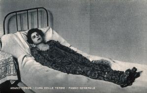 view A woman caked in thermal mud at Abano Terme health spa. Photomechanical reproduction.