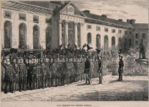 view The Royal Hospital, Chelsea: view of the Pensioners cheering and waving their hats and sticks, at a King Charles's Day Parade. Wood engraving.