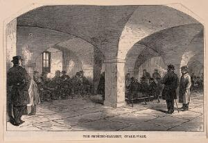 "view Everyday life at Greenwich Hospital: Pensioners smoking in the ""Chalk walk"". Wood engraving by M. Jackson, 1865."