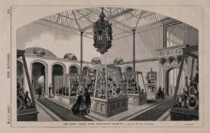 view South Kensington Museum: the interior of the north court, with exhibits and visitors. Wood engraving by W. E. Hodgkin, 1862.