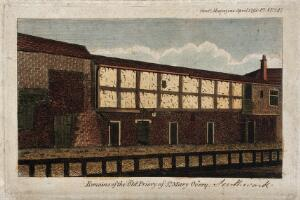 view The ruins of the priory of St. Mary Overie, Southwark: a stone wall and timber framework. Coloured engraving, 1791.