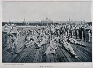 view Boer War: soldiers relaxing by Southampton Water with a view across the estuary to Netley Hospital. Halftone after a photograph by W. Gregory & Co., London.