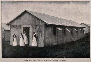 view Boer War: a temporary hospital hut at Netley with four nurses at the door. Halftone, c. 1900.