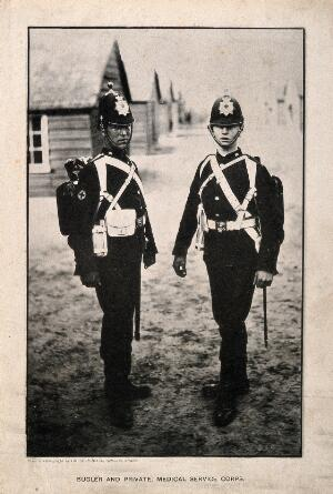 view Two uniformed men from the Medical Service Corps: a bugler and private. Collotype after a photograph.