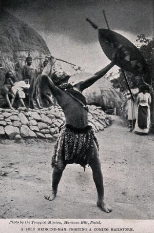 view A Zulu medicine man or shaman performing a ritual to fend off a hailstorm, South Africa. Halftone after Trappist Mission, Natal.