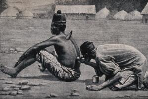 view An African medicine man or shaman applying the technique of cupping to a patient (using animal horns), which involves drawing blood to the surface of the body. Halftone.