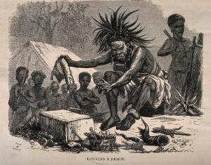 view An African medicine man or shaman using symbols and small animals to eject a demon (disease). Wood engraving by Dalziel after J. Leech.