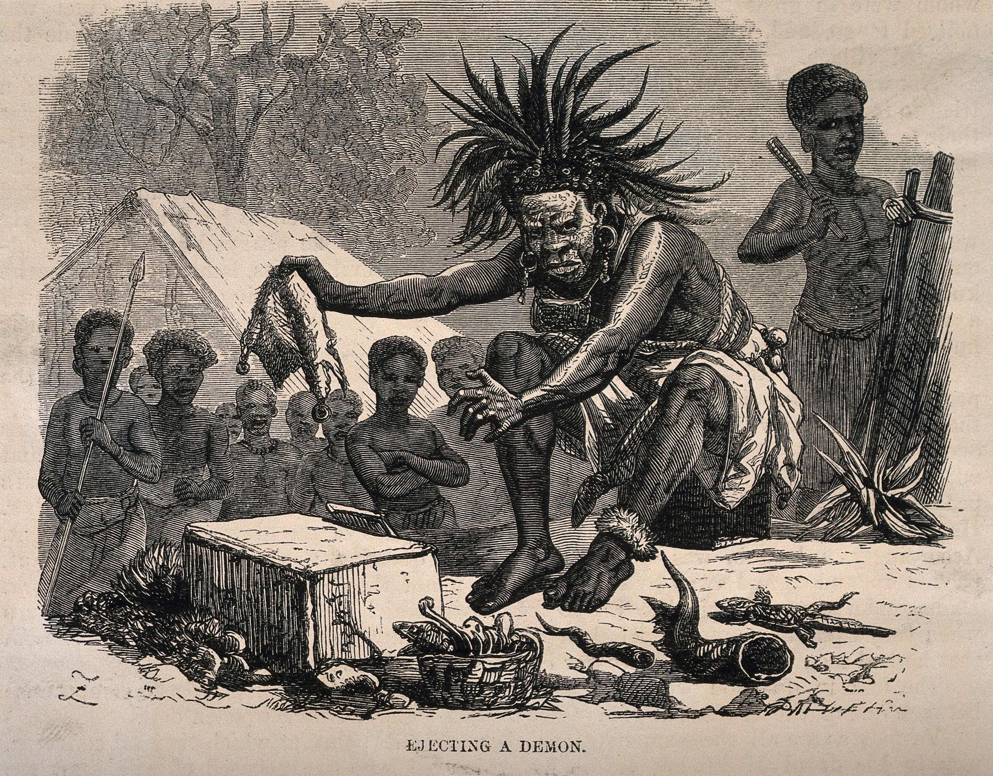 An African medicine man or shaman using symbols and small