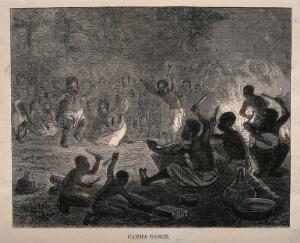 view An African tribe performing a ritual dance in front of a fire. Wood engraving.