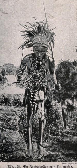 view A Ntumbasee medicine man or shaman in full costume. Halftone.
