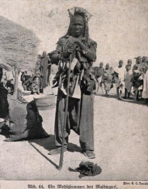 view A Maiduguri medicine man or shaman, Nigeria. Halftone after a photograph by E.L. Temple.
